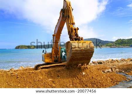 backhoe moving soil