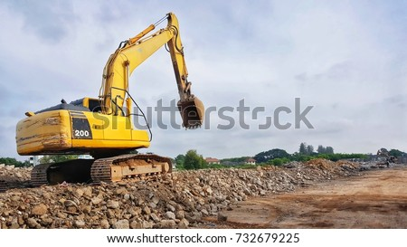 backhoe to excavate the soil on the ground.construction site excavator.wheel loader.