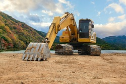 Backhoe to on the ground.construction site at the lagoon, excavator wheel loader.
