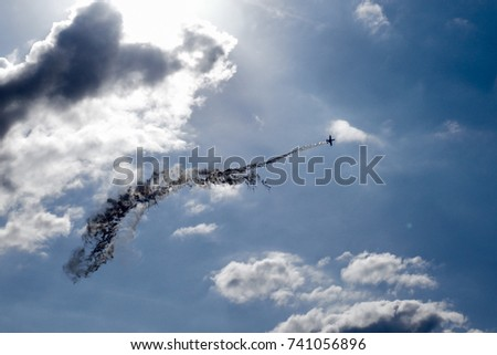 "Backlight photo, ""A-10 Thunderbolt"" attacker flying through the flare"