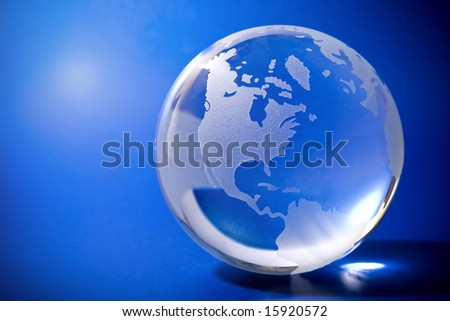 Backlit blue globe with copy-space