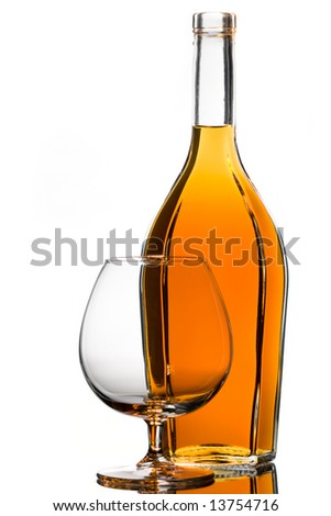 Backlit brandy bottle and an empty glass