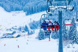 backlit scenes with ski lift chairs on hillside, Levi ski resort, Finland