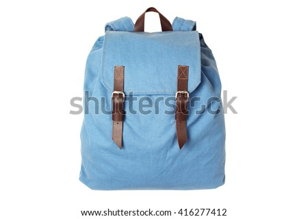 Backpack accessories isolated hipster background white. Blue with brown bag. Hand made backpack for travelers.