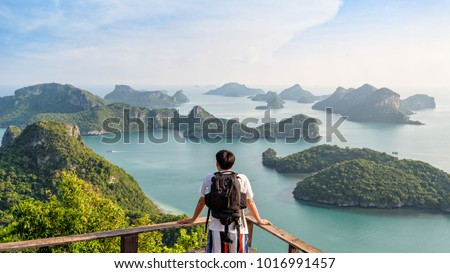 Backpack Asian man on the mountain see view panorama the beautiful nature landscape of the sea adventure on vacation travel leisure to Asia on Mu Ko Ang Thong island National Park background, Thailand