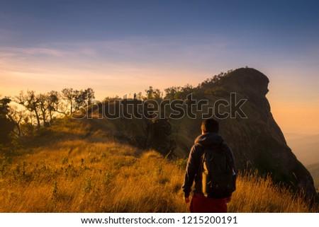 backpacker and sunlight in the morning at doi mon jong , Chiang Mai , Thailand Stockfoto ©