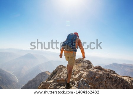 Backpacker in hike in the summer mountains #1404162482