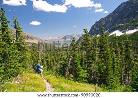 Backpacker in the Lake Okatomi Trail In Glacier National Park