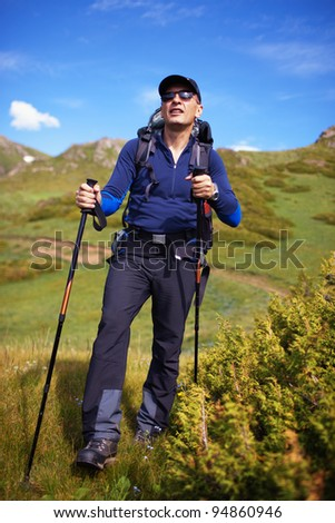 Backpacker in the wilderness mountains
