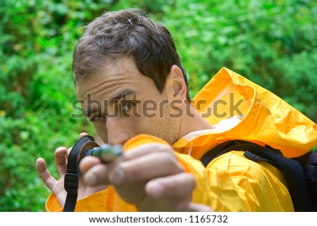 Backpacker pointing with a stick