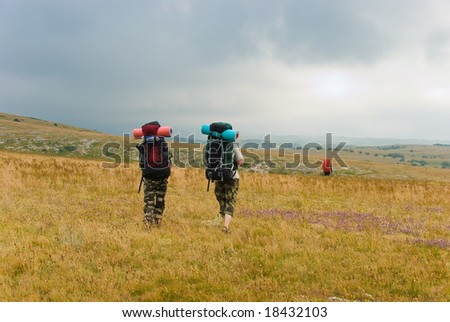 Backpackers hike in mountains