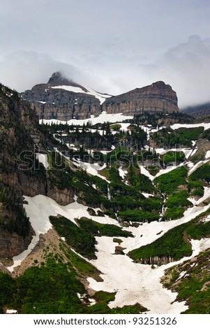 Backside of Mount Timpanogos with terraced grass and snow