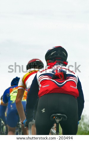 Backside view of three Cyclists in a row - stock photo