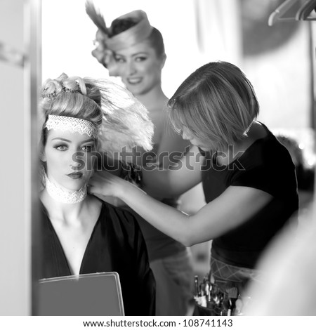 backstage hairdressing and makeup fashion with make-up artist