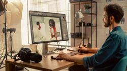 Backstage of the Photoshoot: Photo Editor Works on Desktop Computer Retouching Photos of Beautiful Black Model with Image Editing Software. Fashion Internet Magazine