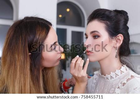 backstage photo as visagiste applying lip gloss #758455711