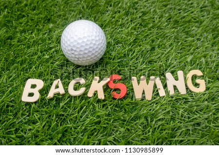 Backswing golf terms is on green grass