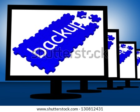 Backup On Monitors Shows Programs Recovery Or Restoration - stock photo