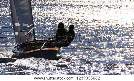 backview of a couple in a sailing boat