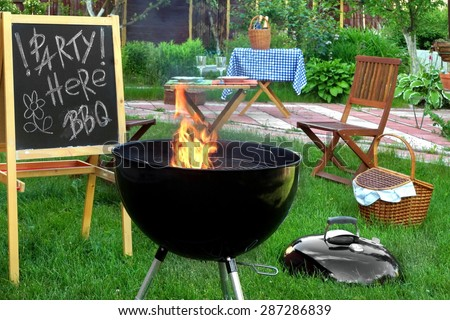 Backyard BBQ Grill Party Scene.Chalkboard With Sign Party Here BBQ, Flaming Grill, Wood Outdoor Furniture, Garden Decoration, Wine, Picnic Basket