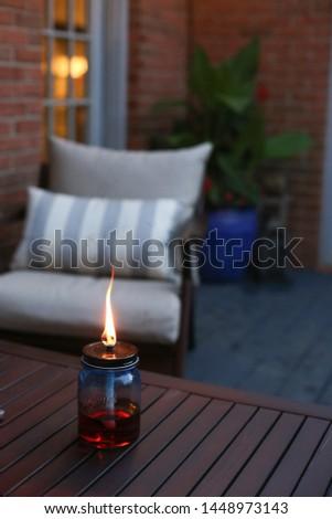 Backyard Deck Torch Glowing in Summer #1448973143