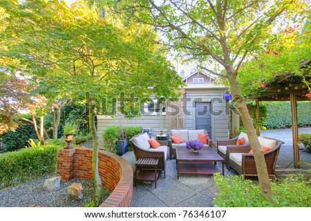 Backyard luxury outdoor living room with sofas - stock photo