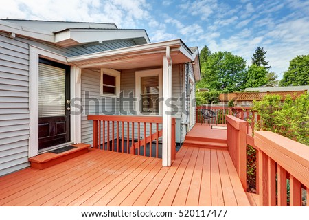 Backyard of craftsman home with red deck. Northwest, USA  #520117477
