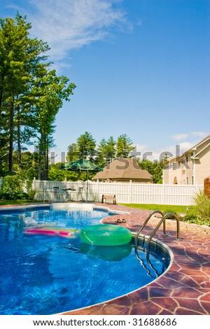 Backyard pool on a summer day.