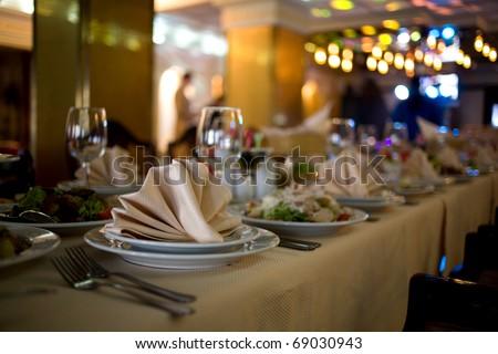Backyard table full of food - stock photo