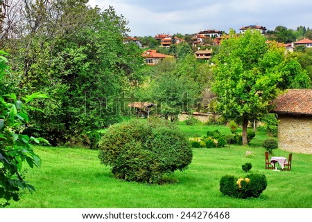 Backyard with Decorative Garden and Outdoors Furniture. Bulgarian Summer Landscape.