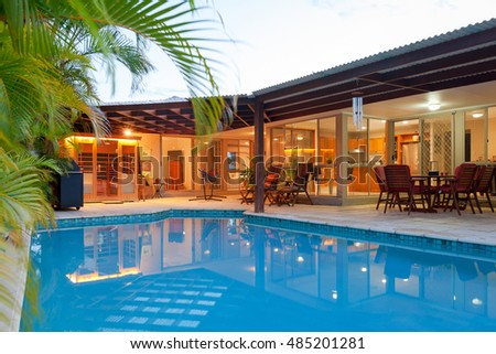 Backyard with swimming pool in stylish home - Shutterstock ID 485201281
