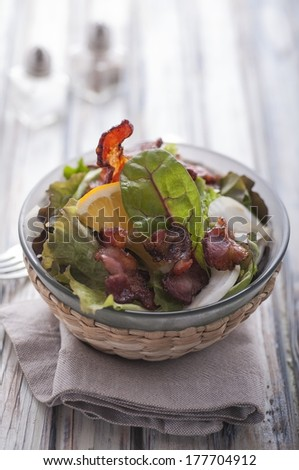 Bacon and lettuce salad on wood table