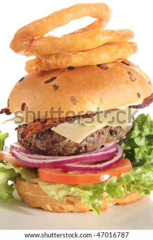 Bacon Cheese Burger and onion rings isolated on white.