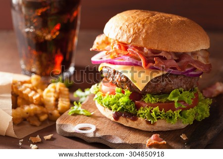 Stock Photo bacon cheese burger with beef patty tomato onion cola