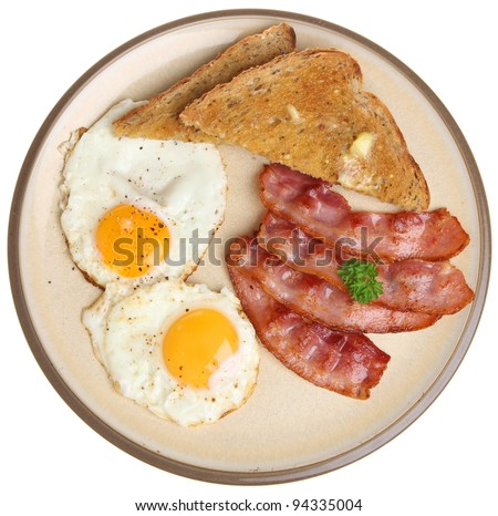 Bacon, fried eggs and buttered toast