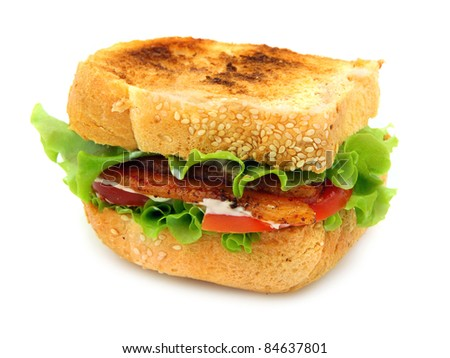 Bacon, Lettuce and Tomato sandwich on lightly toasted thickly sliced homemade bread. Isolated on white background.