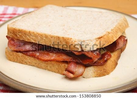 Bacon sandwich on plate.