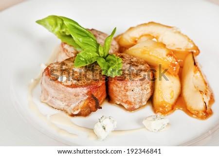 Bacon wrapped mackerel fillet with saffron sauce and potato