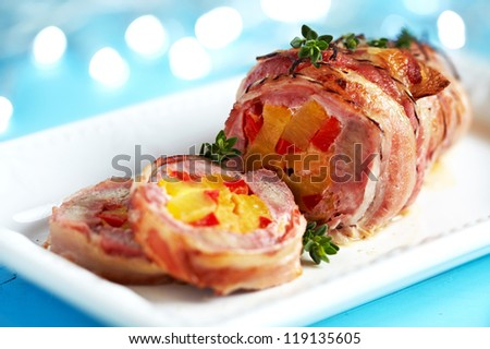 Bacon wrapped pork with pineapple and pepper