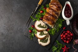 bacon wrapped turkey breast stuffed with spinach and cheese for Christmas dinner, top view, copy space