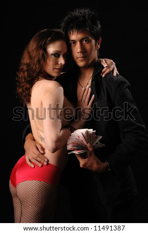 stock photo : Bad boy magician and his sexy nude assistant