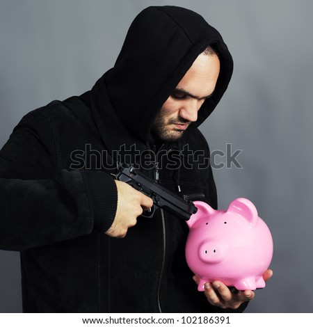 bad boy with pink piggy bang and gun in the hand