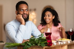 Bad Date. African American Couple Having Unsuccessful Blind Date In Restaurant, Funny Disappointed Shoked Black Man Feeling Embarrassment Listening To Excited Woman Talking