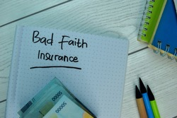 Bad Faith Insurance write on a book isolated on office desk. Selective focus on Bad Faith Insurance text