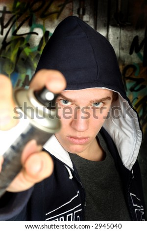 Bad guy with spray. See other photos of teenagers in my portfolio.