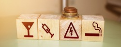 Bad habits icones on natural wooden blocks. Drinking, using drugs and smoking danger icons. Prevent addictions healthcare concept.