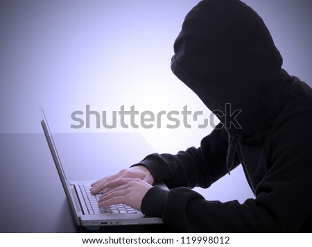 bad hacker working on an internet crime