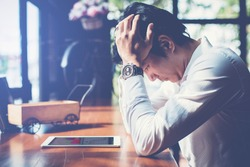 Bad investment or economic crisis concept. Businessman is disappointed from losing in stock exchange.