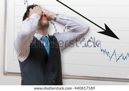 Bad investment or economic crisis concept. Businessman is disappointed from losing in stock exchange. Chart with arrow down on whiteboard in background. Foto d'archivio ©