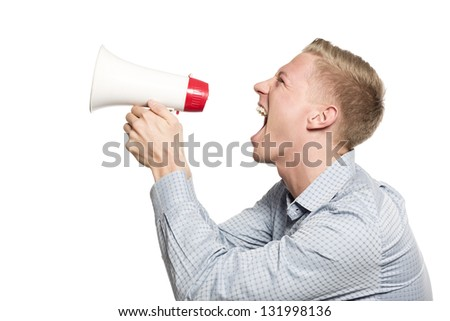 Bad news: Angry businessman shouting with megaphone isolated on white background.
